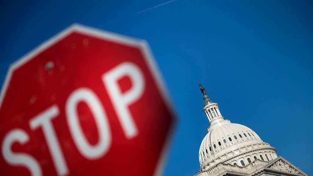 Capitol Hill is seen agains a blue sky while the government begins a shutdown January 20, 2018 in Washington, DC.