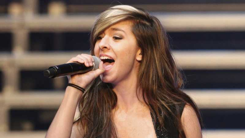 "In this June 29, 2014 file photo, ""The Voice"" Season 6 contestant Christina Grimmie performs as part of ""The Voice Tour"" at Cobb Energy Centre, in Atlanta"