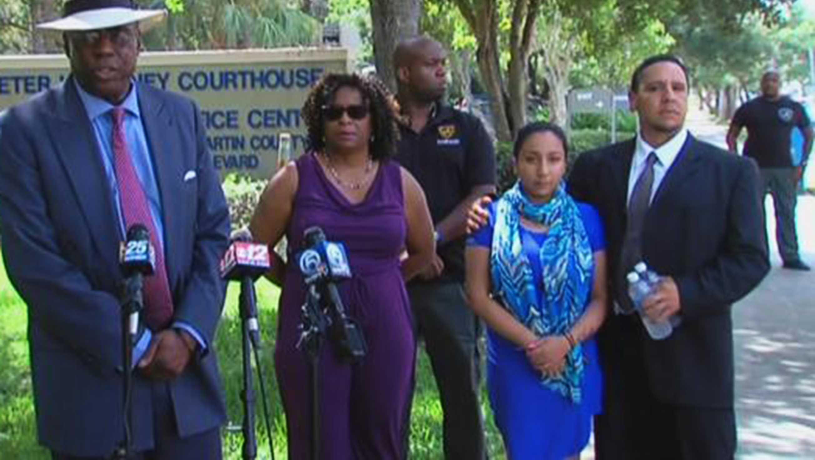 'Jasmine,' also known as Celeste Guap stands next to her attorney.