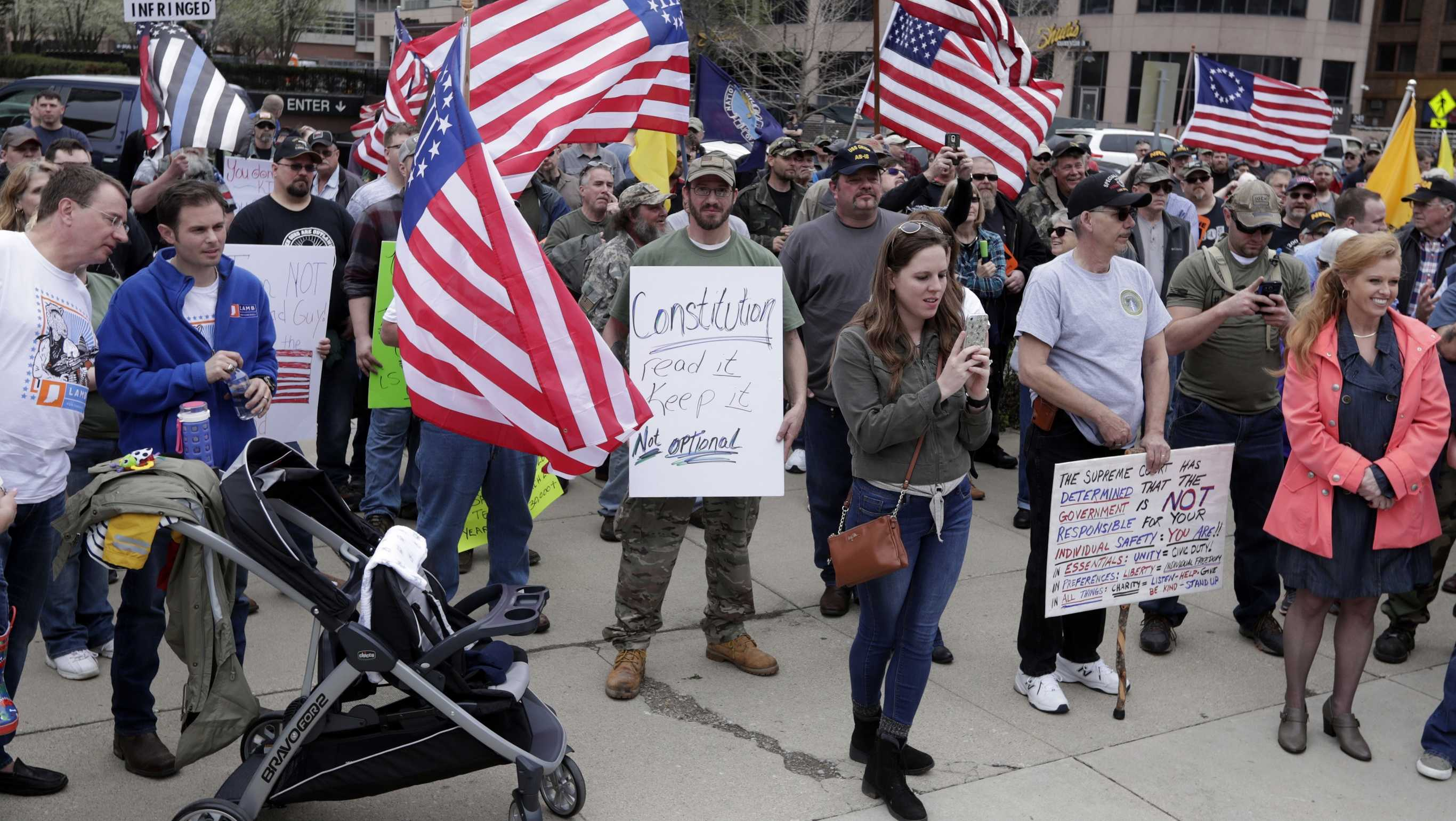 People participate in a gun-rights rally at the state capitol, Saturday, April 14, 2018, in Indianapolis.