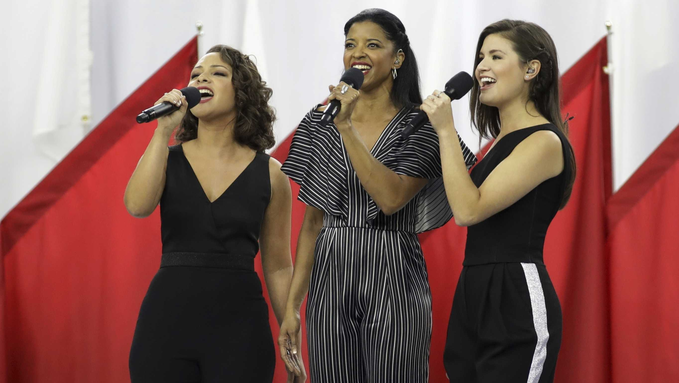 "Singers of the cast of Hamilton, Phillipa Soo, right, Rene Elise Goldsberry, center, and Jasmine Cephas Jones, sing ""God Bless America"", before the NFL Super Bowl 51 football game between the New England Patriots and the Atlanta Falcons, Sunday, Feb. 5, 2017, in Houston."