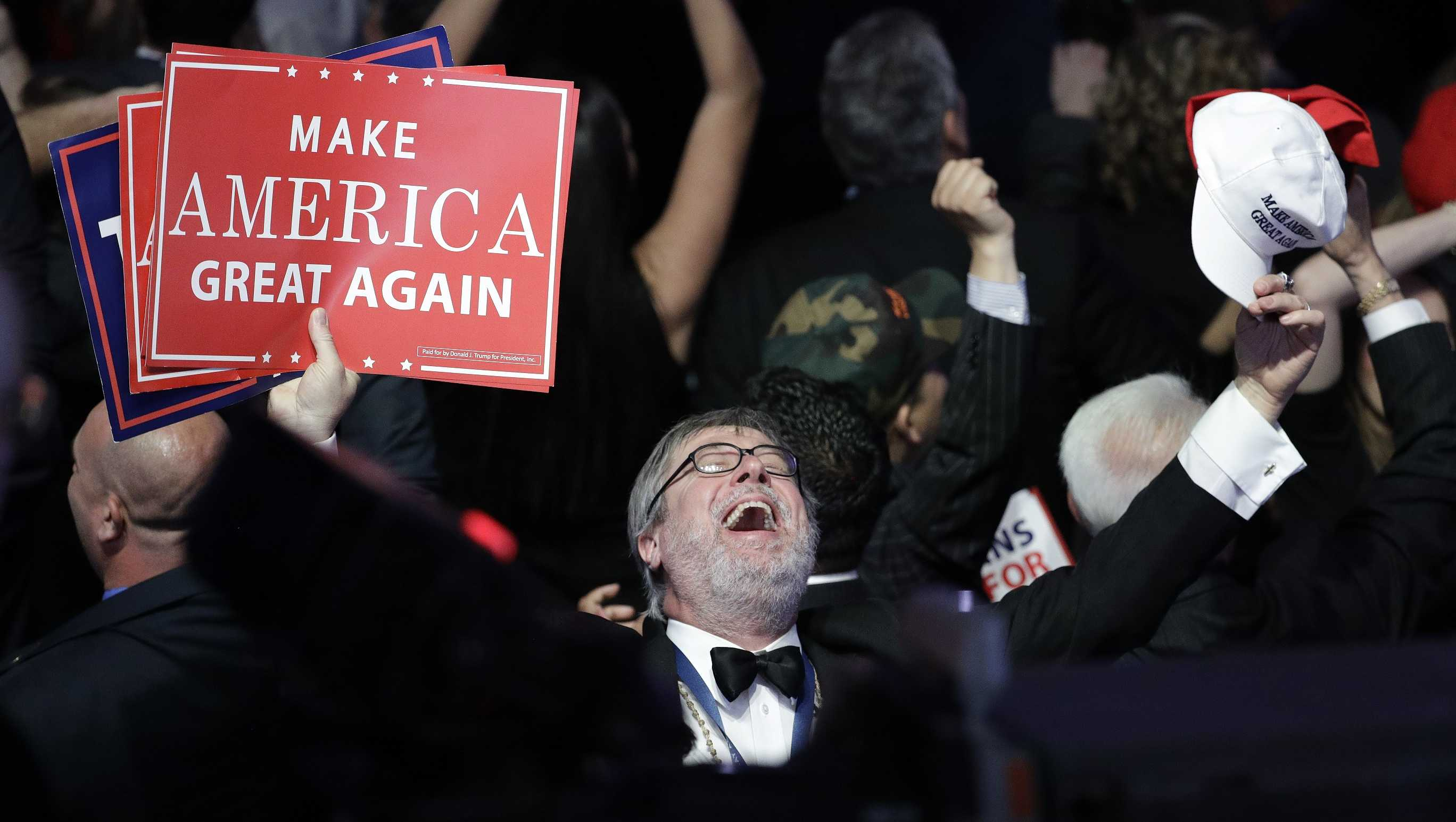 Supporters of Republican presidential candidate Donald Trump react as they watch the election results during Trump's election night rally.