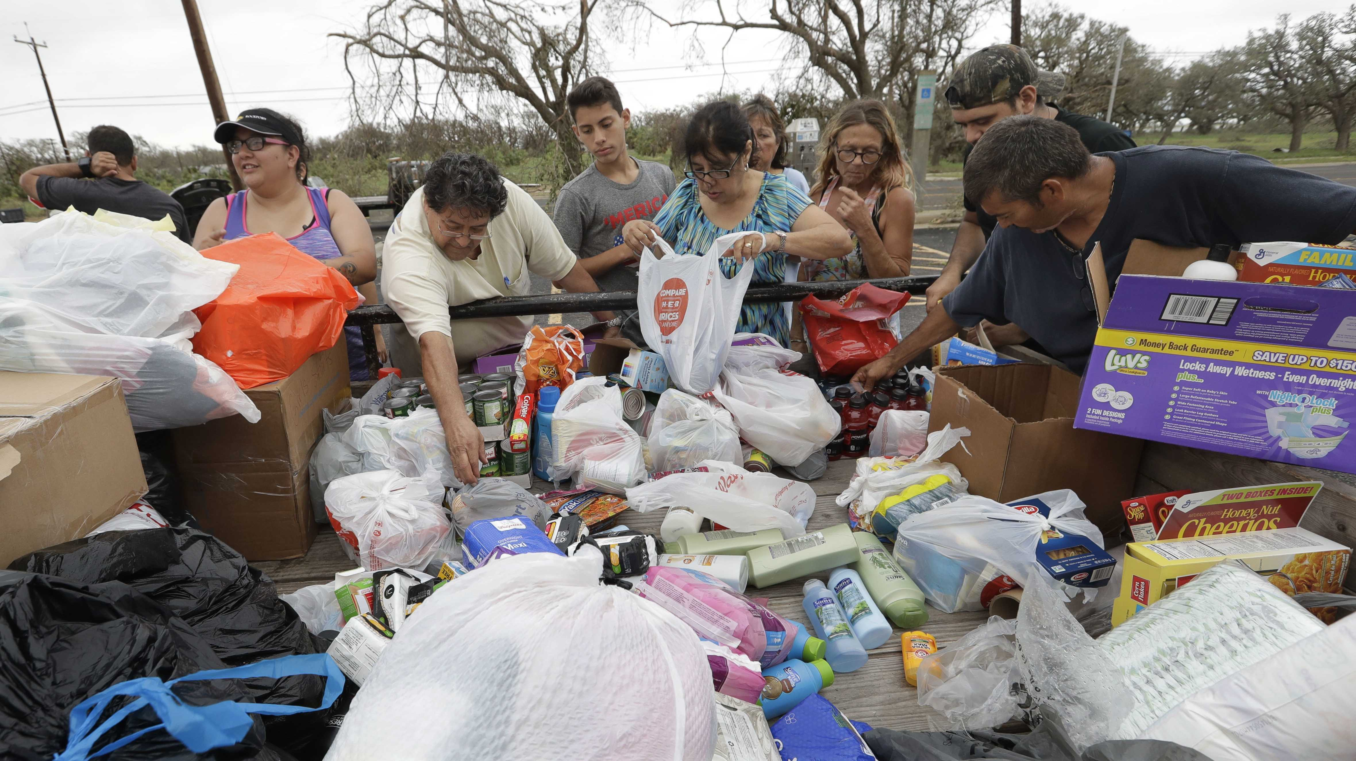 Residents pick through needed items at a make-shift aid station, Sunday, Aug. 27, 2017, in Rockport, Texas. A group from the Texas Rio Grande Valley created station for those in need following Hurricane Harvey.