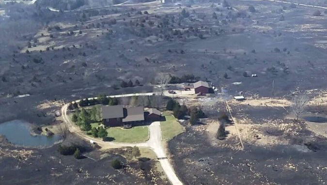 Fire crews saved a home near Hutchinson, Kansas, from the wildfires.