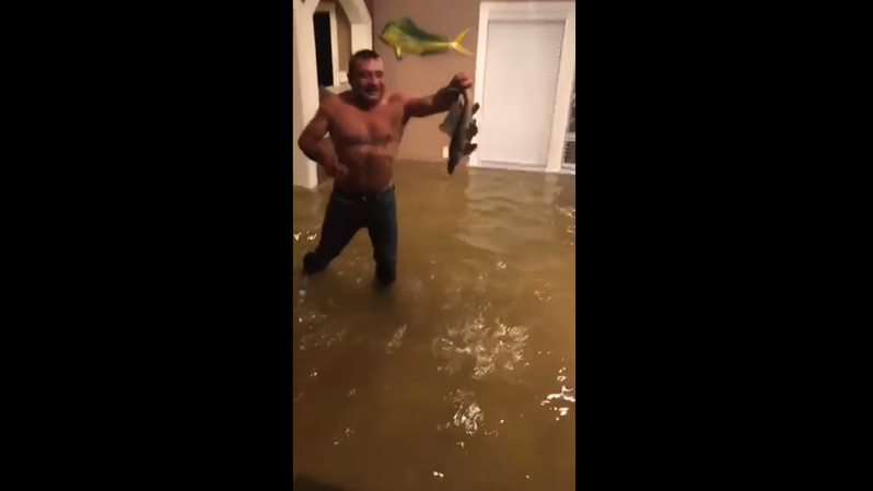 Houston Woman Goes Viral With Videos Of Man Trying To Catch Fish In Flooded Home