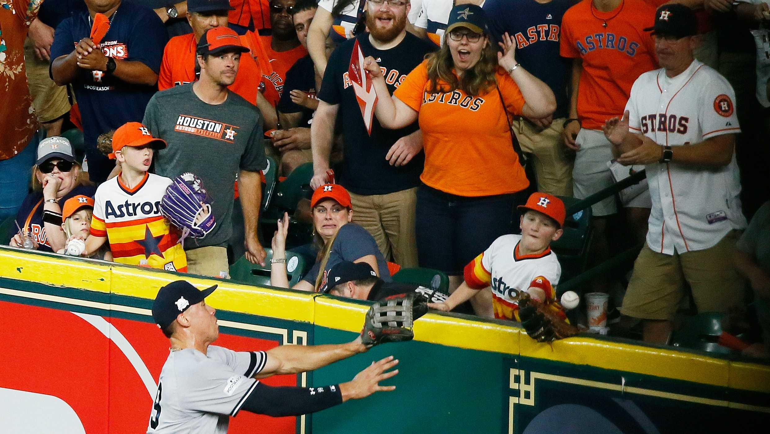 Carson Riley catches a home run hit by the Houston Astros' Carlos Correa in the fourth inning of Game 2 of the ALCS, Oct. 14, 2017.