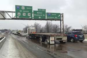 Traffic, stalled on icy westbound Interstate 55 heading towards Arkansas, approaches a bridge over the Mississippi River in Memphis, Tenn., Tuesday, March 4, 2014.