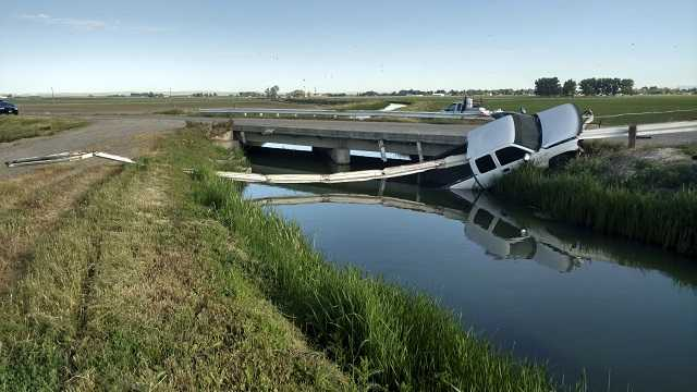 This Sunday, June 4, 2017 photo shows where a stolen pickup truck was found impaled on about 30 feet of guard rail over a canal near Aberdeen in eastern Idaho.
