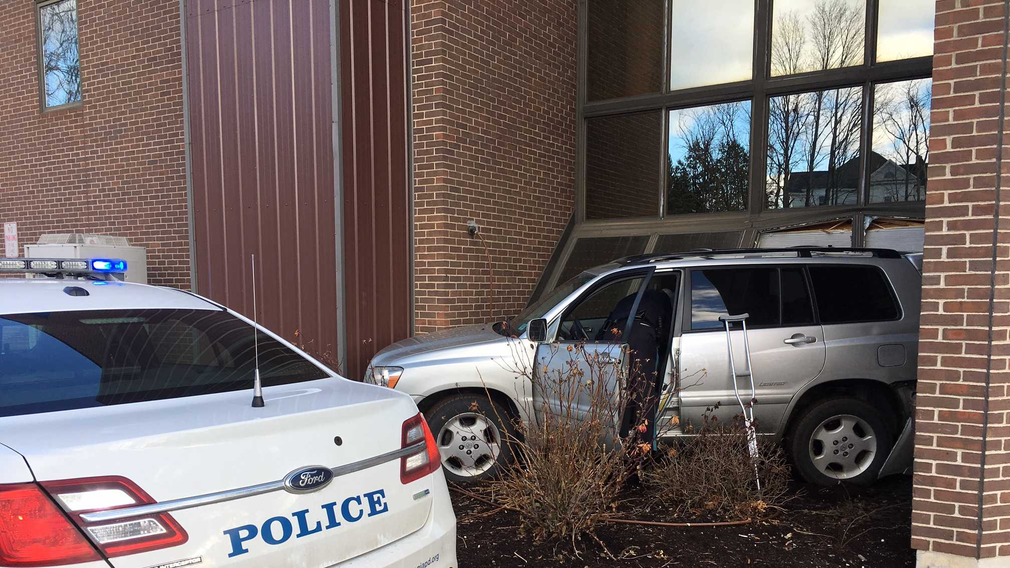 Vehicle crashes into Laconia building