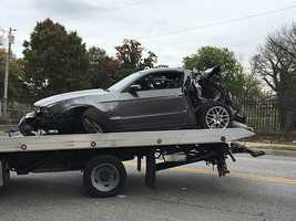 Car removed from bus crash scene