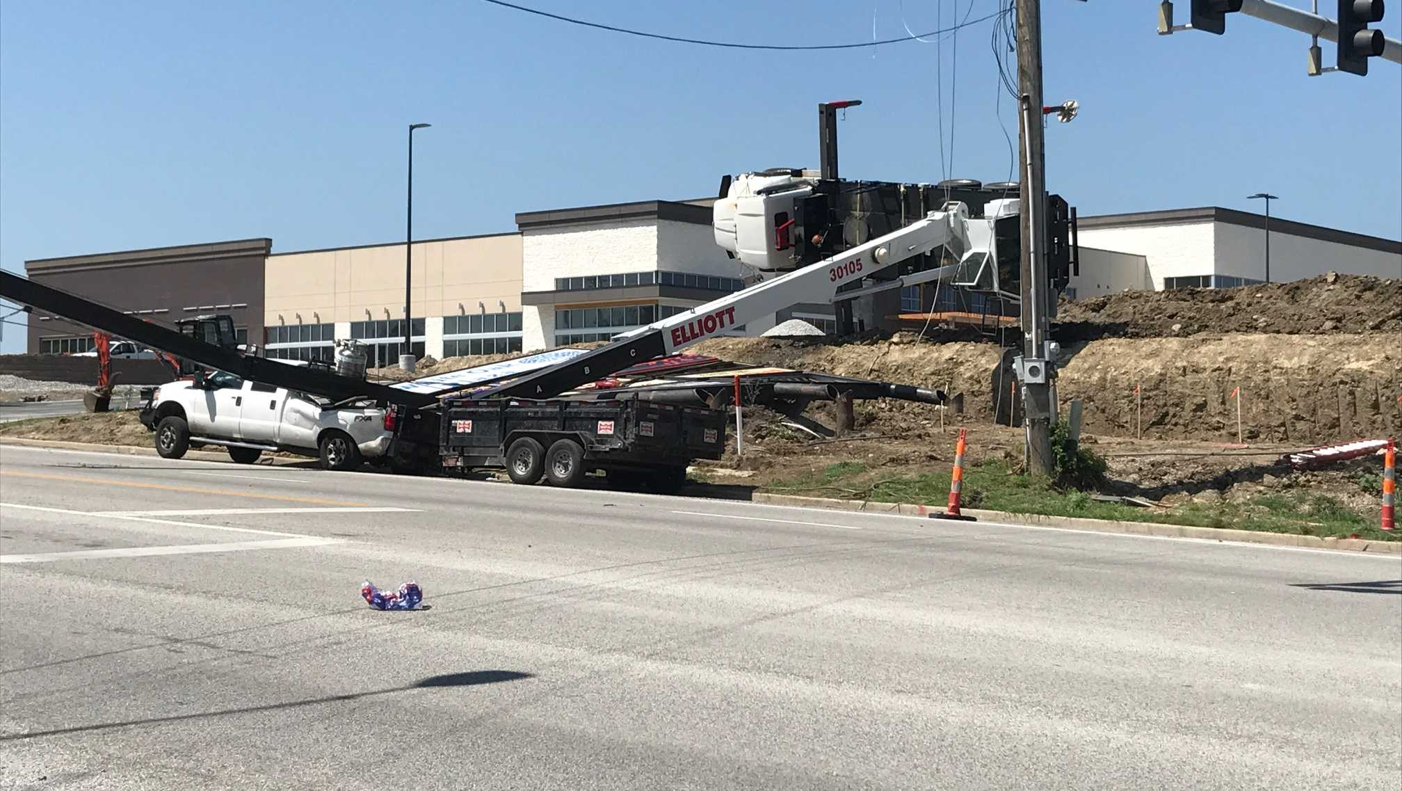 Crane truck tips over in Blue Springs