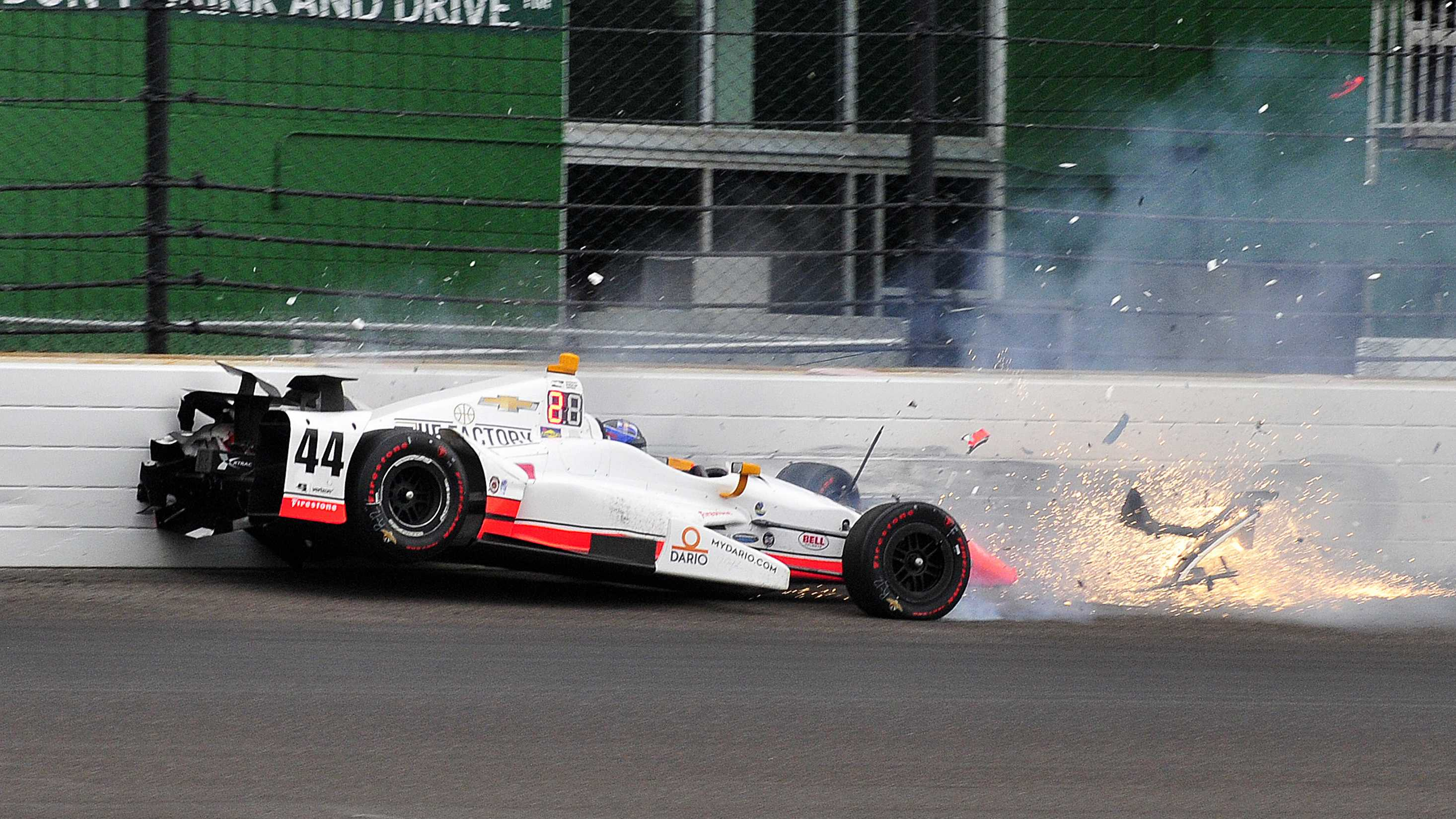 The car driven by Buddy Lazier hits the wall in the second turn during the running of the Indianapolis 500 auto race at Indianapolis Motor Speedway, Sunday, May 28, 2017, in Indianapolis. (AP Photo/John Maxwell)