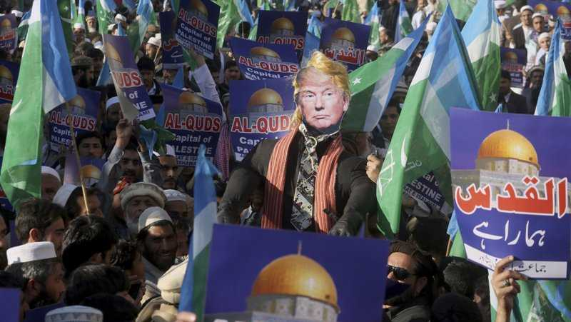 Supporters of Jamaat-e-Islami take part in an anti-American rally to condemn U.S. President Donald Trump for declaring Jerusalem as Israel's capital, in Peshawar, Pakistan, Friday, Dec. 22, 2017.
