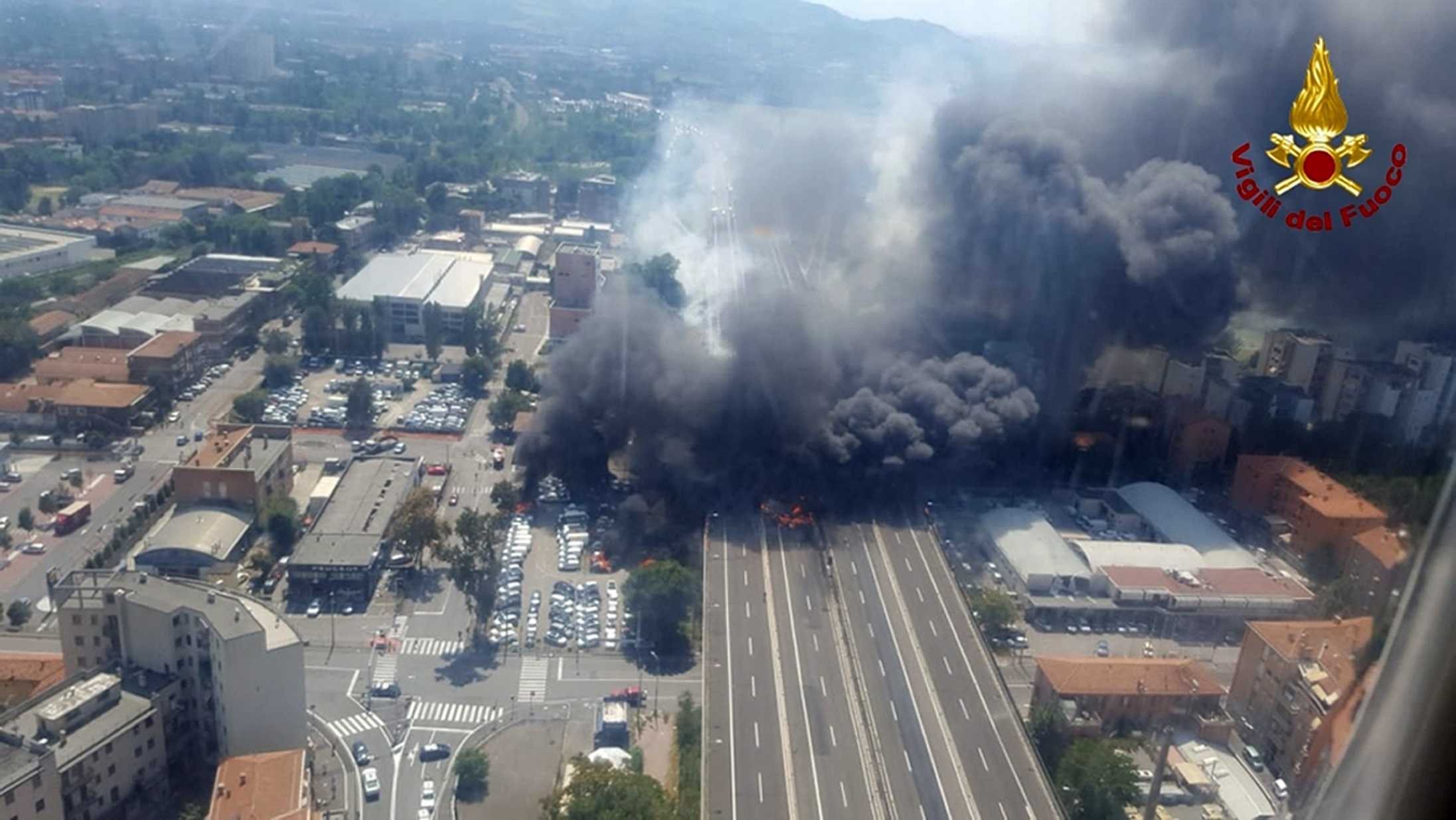 In this photo released by the Italian firefighters, an helicopter view of the explosion on a highway in the outskirts of Bologna, Italy, Monday, Aug. 6, 2018. The explosion was reportedly caused by an accident involving a truck that was transporting flammable substances and exploded upon impact.