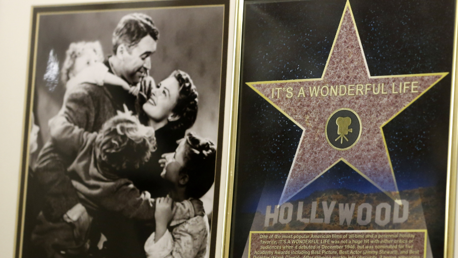 "In this photo made on Friday, Dec. 20, 2013, a framed plaque with a photograph of a scene from the 1946 film ""It's A Wonderful Life"" starring Jimmy Stewart, left, and a Hollywood star are on display at the Jimmy Stewart Museum in Indiana, Pa."