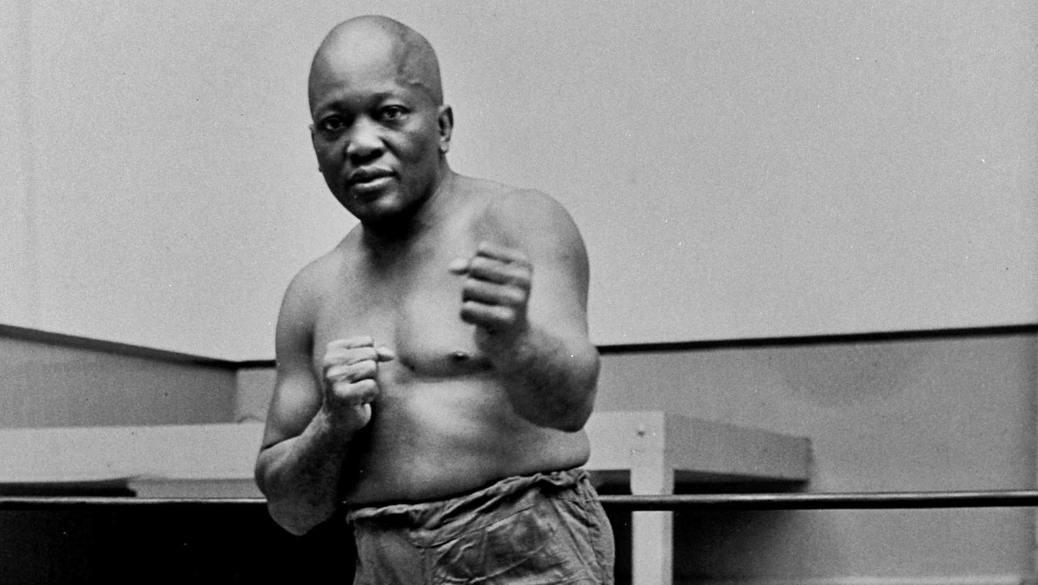 In this 1932 file photo, boxer Jack Johnson, the first black world heavyweight champion, poses in New York City.