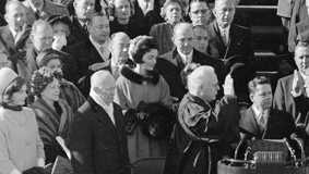 Jackie Kennedy stands near John F. Kennedy during his inauguration.