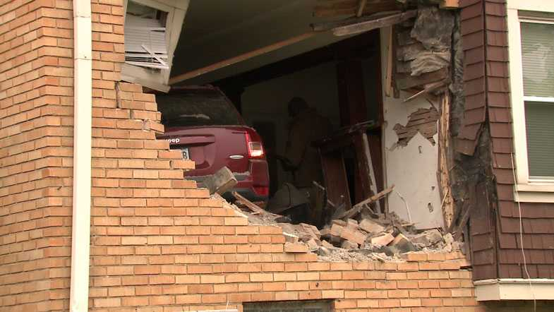 Airborne Jeep slams into apartment living room