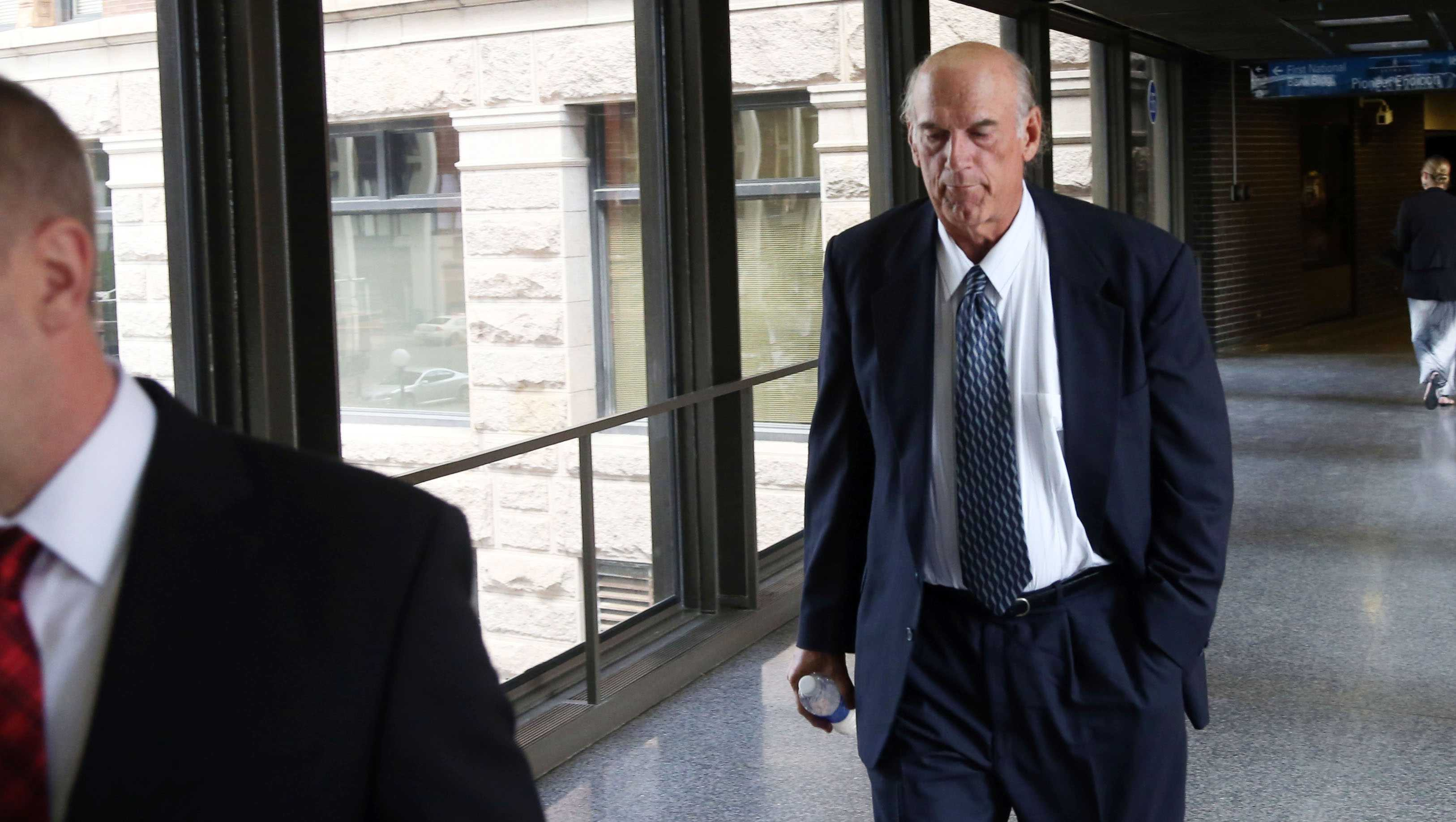 Former Minnesota Gov. Jesse Ventura returns from lunch to the federal courthouse in St. Paul, Minn., Tuesday, July 8, 2014.