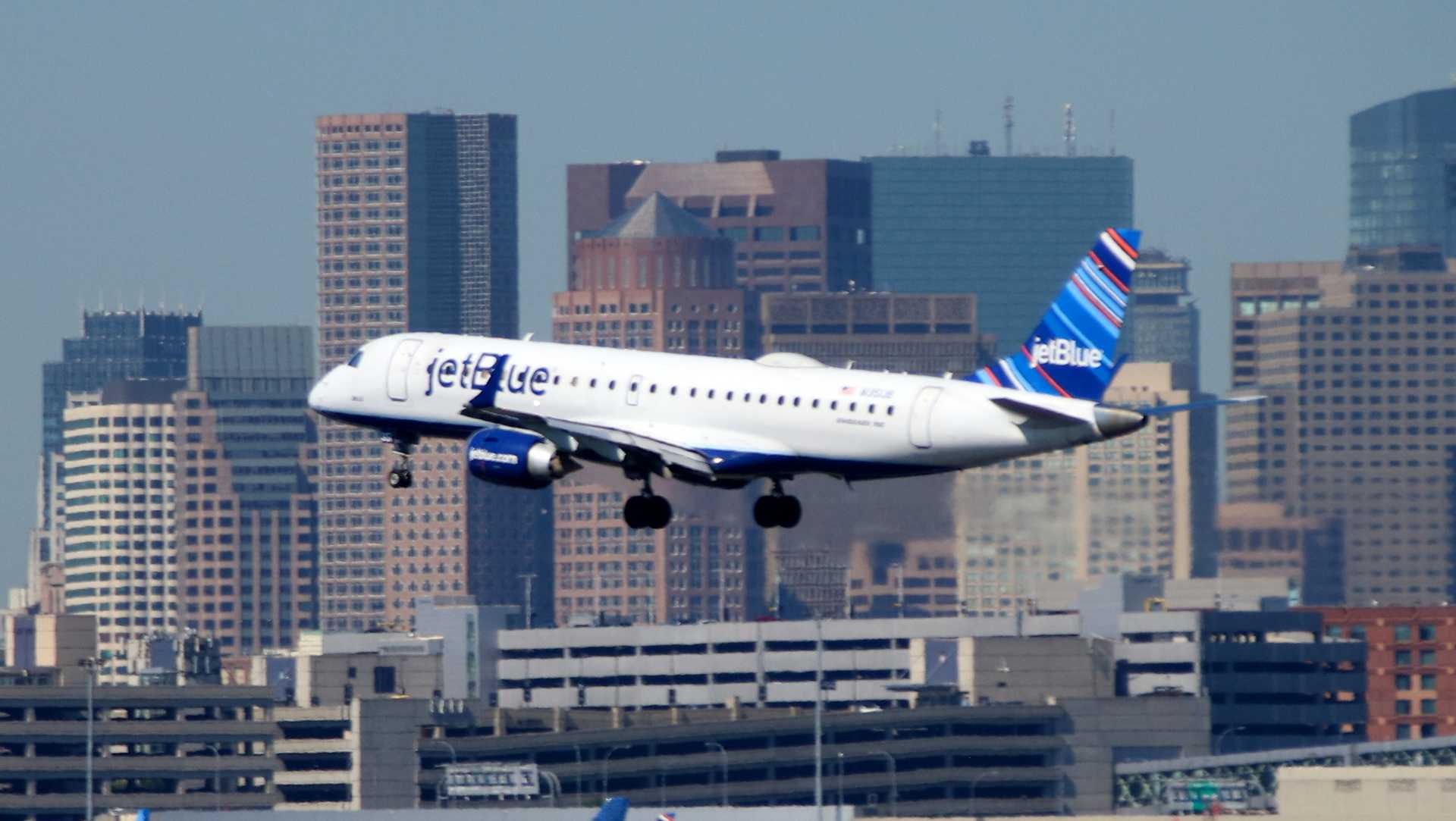 A JetBlue plane lands at Logan Airport in Boston.