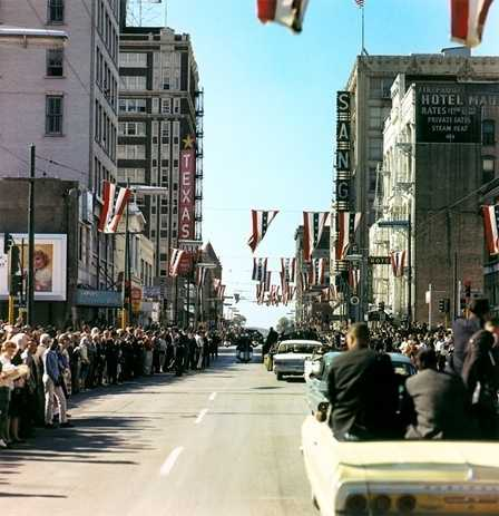Presidential motorcade on Main Street at Griffin Street, Dallas, Texas, on the day JFK was assassinated. Photograph by Cecil Stoughton, White House, in the John F. Kennedy Presidential Library and Museum, Boston.