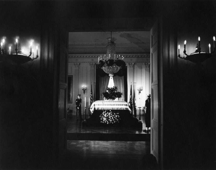 View of President John F. Kennedy's flag-draped casket in the East Room of the White House, as the late president lies in repose. Washington, D.C.