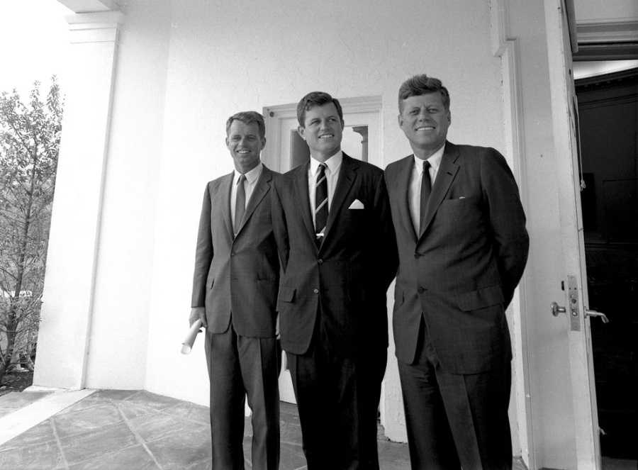 President John F. Kennedy poses with his brothers in the West Wing Colonnade outside the Oval Office, White House, Washington, D.C. (L-R) Attorney General Robert F. Kennedy&#x3B; Senator Edward M. Kennedy (Massachusetts)&#x3B; President Kennedy.