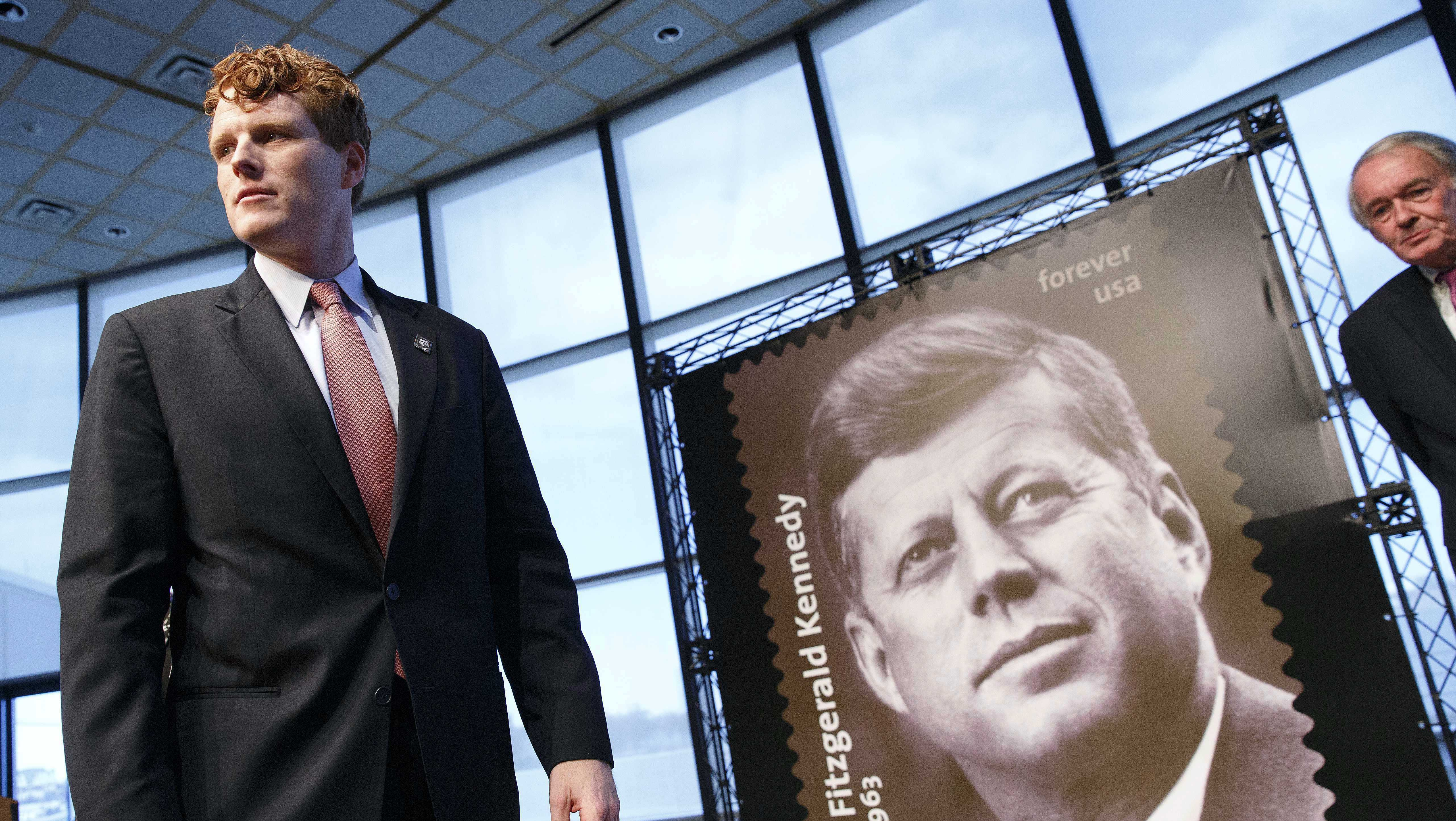 Rep. Joseph P. Kennedy III, D-Mass., left, stands beside the John F. Kennedy Centennial Stamp following dedication ceremonies for the stamp at the John F. Kennedy Library in Boston, Monday, Feb. 20, 2017.
