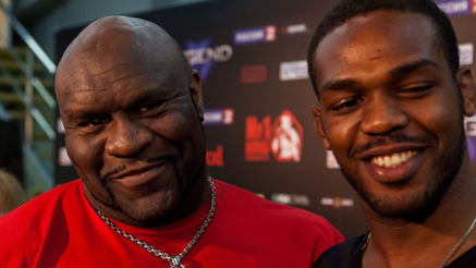 Professional wrestler Bob Sapp (left), with Jon Jones (right).