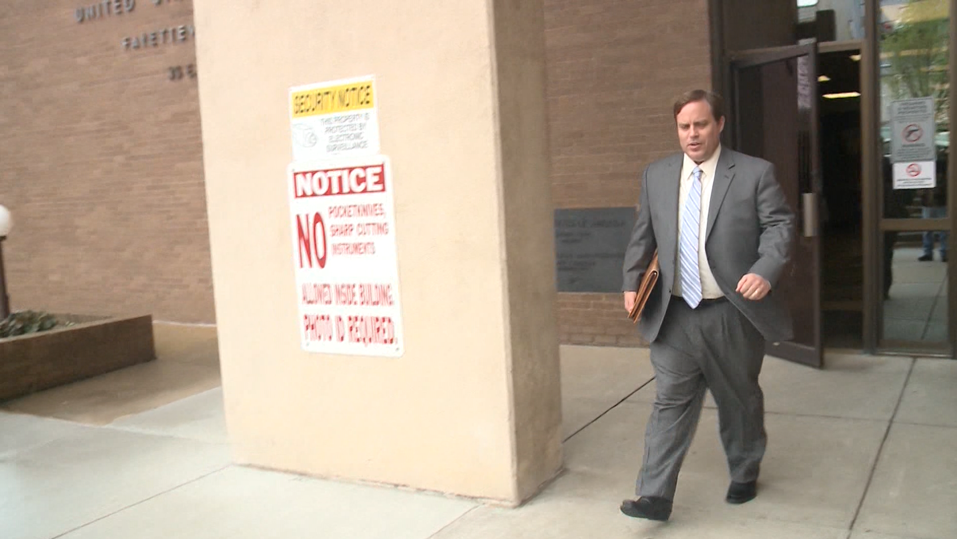 FILE image of Jon Woods exiting court during his trial