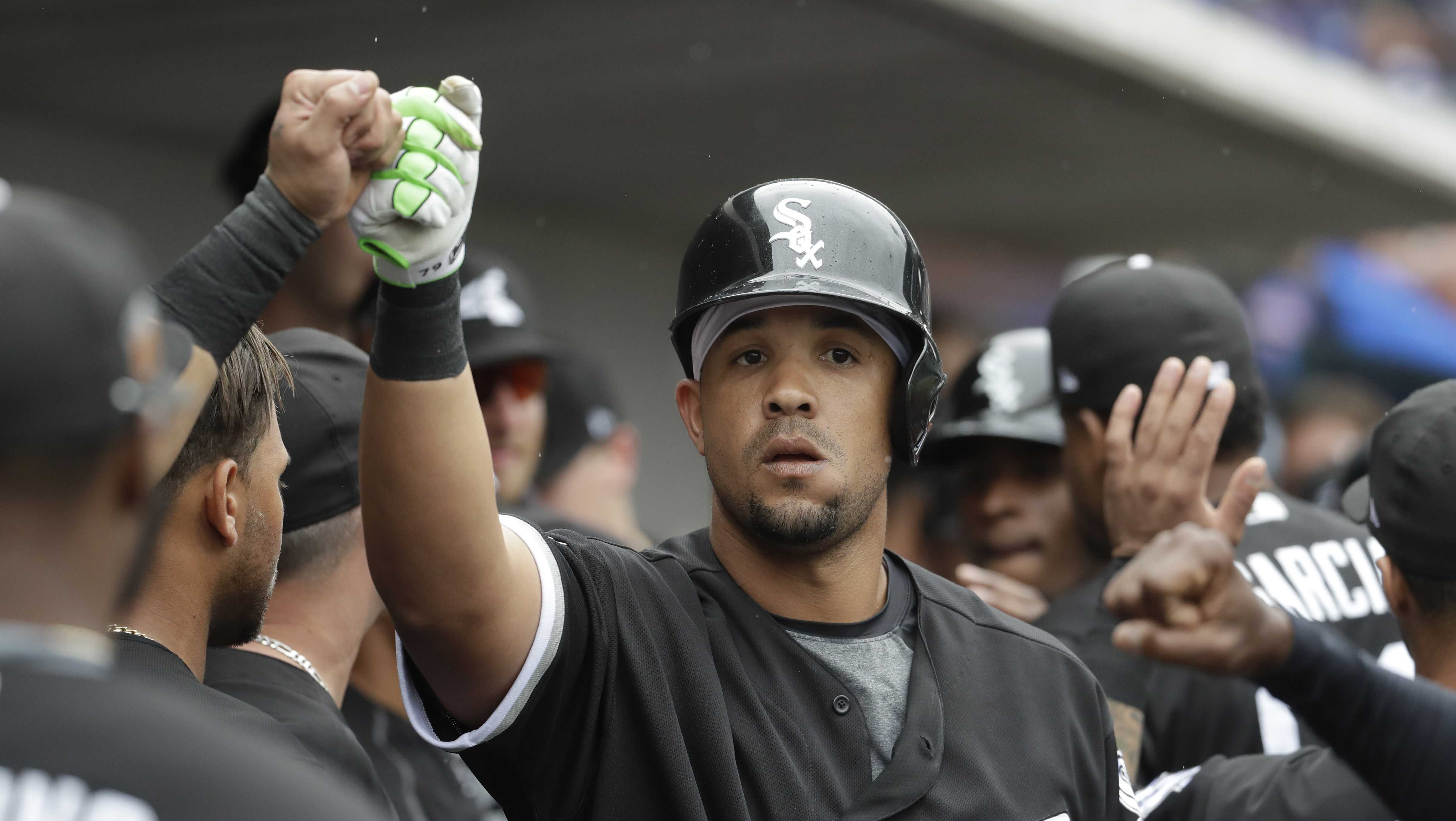 Chicago White Sox's Jose Abreu is congratulated after hitting a two-run home run during the fifth inning a spring training baseball game against the Chicago Cubs Monday, Feb. 27, 2017, in Mesa, Ariz.