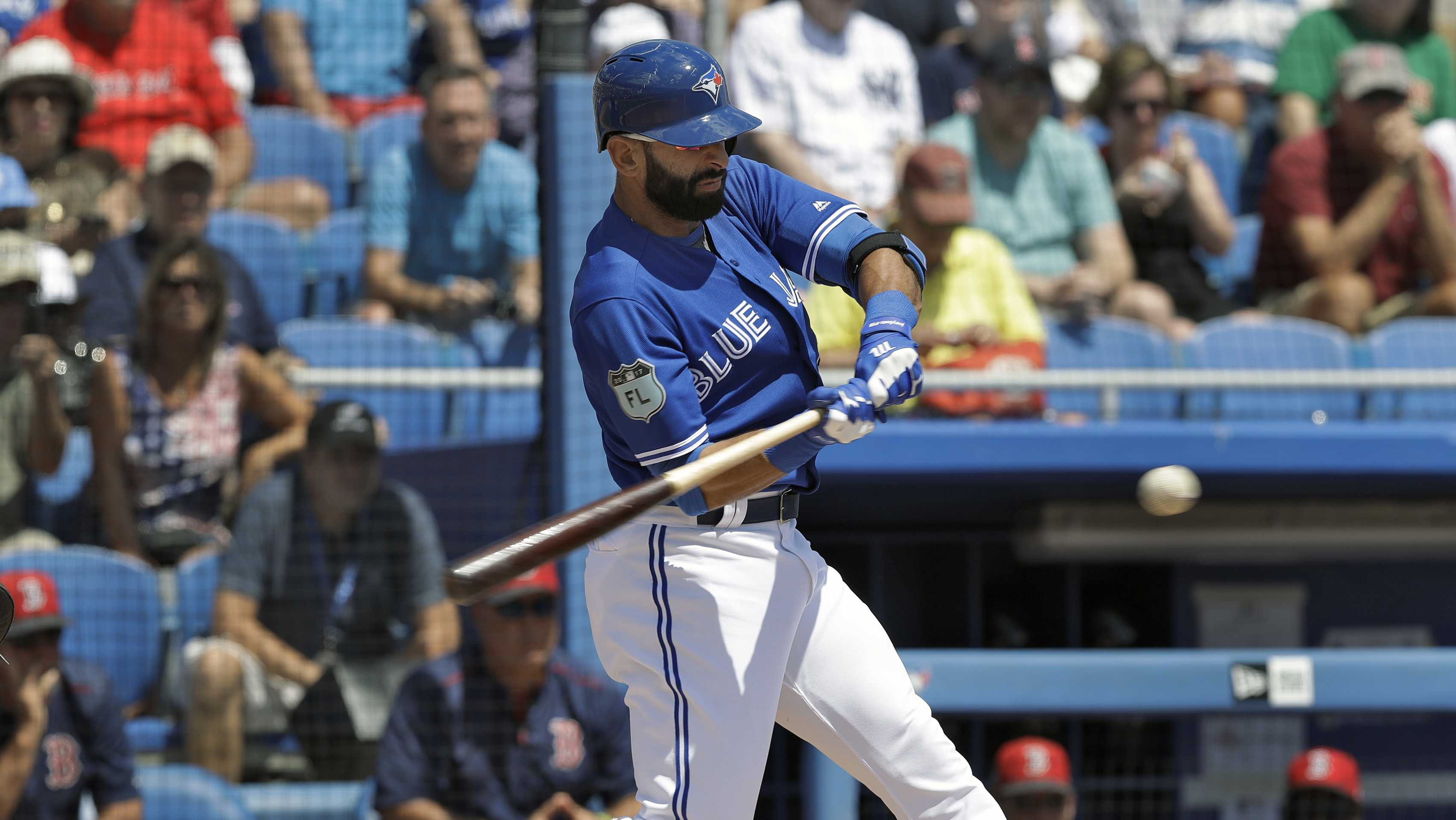 Toronto Blue Jays' Jose Bautista connects for an RBI double off Boston Red Sox starting pitcher Drew Pomeranz during the first inning of a spring training baseball game Friday, March 24, 2017, in Dunedin, Fla.