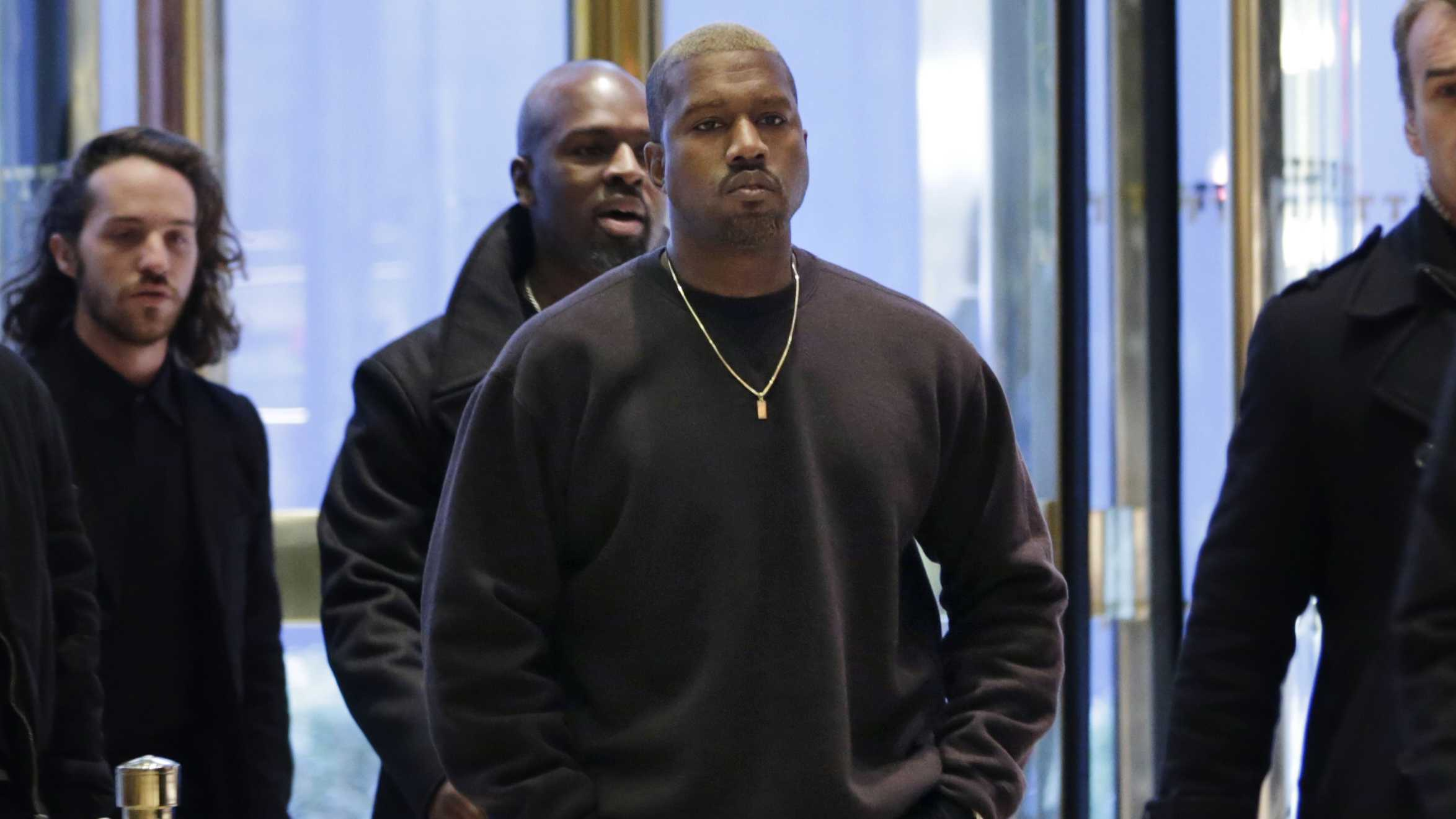 Kanye West enters Trump Tower in New York, Tuesday, Dec. 13, 2016.