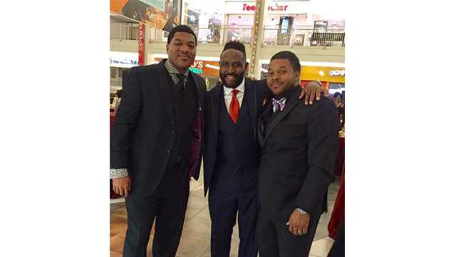 Baltimore police spokesman T.J. Smith, former NFL star Keion Carpenter and Kedrick Orange pose at the Black Tie Affair at Mondawmin Mall last summer. Carpenter died this week at the age of 39.