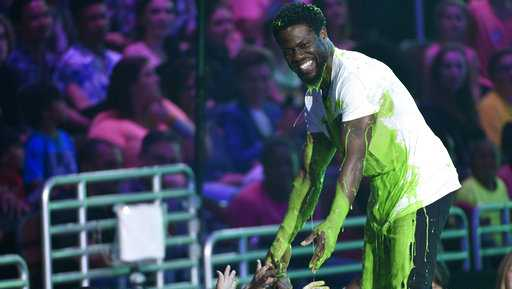 "Kevin Hart after accepting the award for favorite villain for ""The Secret Life of Pets"" and being slimed, greets fans in the audience at the Kids' Choice Awards at the Galen Center on Saturday, March 11, 2017, in Los Angeles."