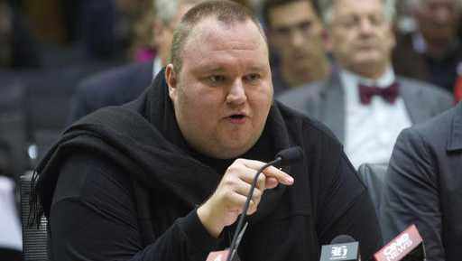 In this Wednesday, July 3, 2013 file photo, Internet entrepreneur Kim Dotcom speaks during the Intelligence and Security select committee hearing at Parliament in Wellington, New Zealand. Internet entrepreneur Kim Dotcom wants to livestream his legal battle against the United States on YouTube. Dotcom's lawyers have asked if they can film his extradition appeal, which began Monday, Aug. 29, 2016, at New Zealand's High Court in Auckland. The U.S. opposes the plan.
