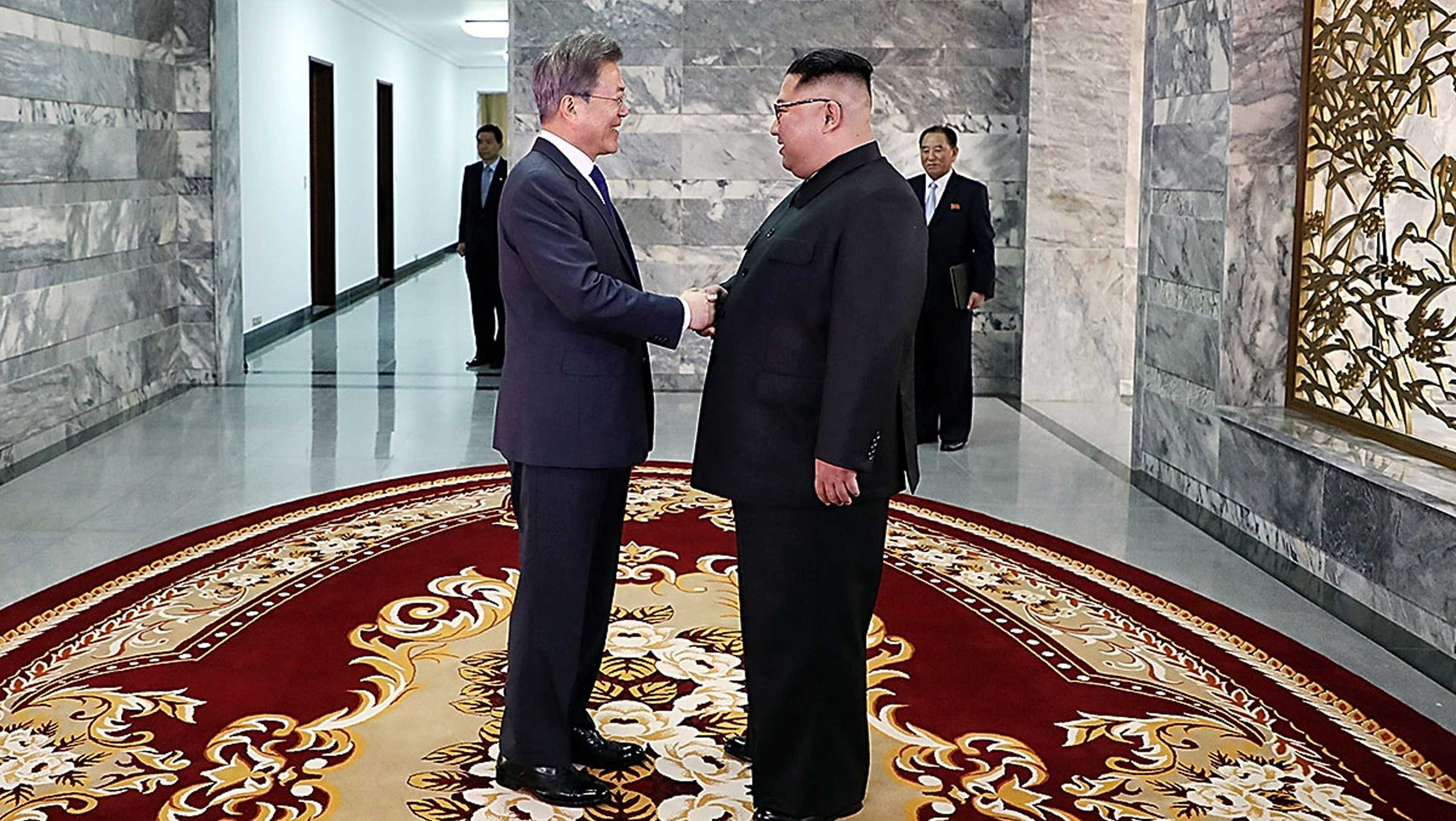 In this handout image provided by South Korean Presidential Blue House, South Korean President Moon Jae-in (L) shake hands with North Korean leader Kim Jong Un (R) before their meeting on May 26, 2018 in Panmunjom, North Korea.