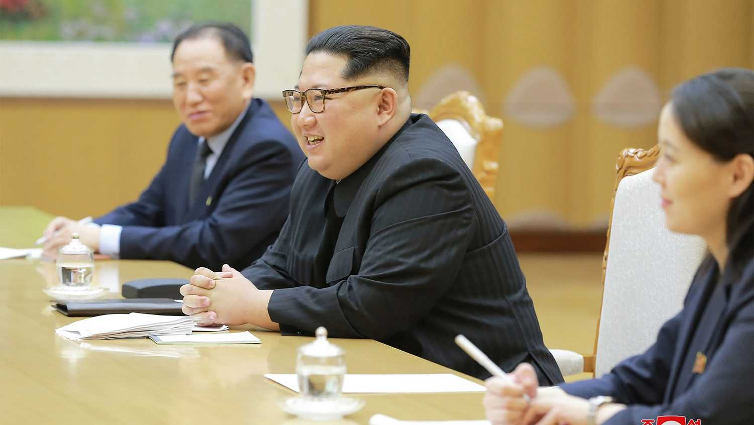 This picture taken on March 5, 2018 and released from North Korea's official Korean Central News Agency (KCNA) on March 6, 2018 shows North Korean leader Kim Jong-Un (C) meeting with South Korean delegation.