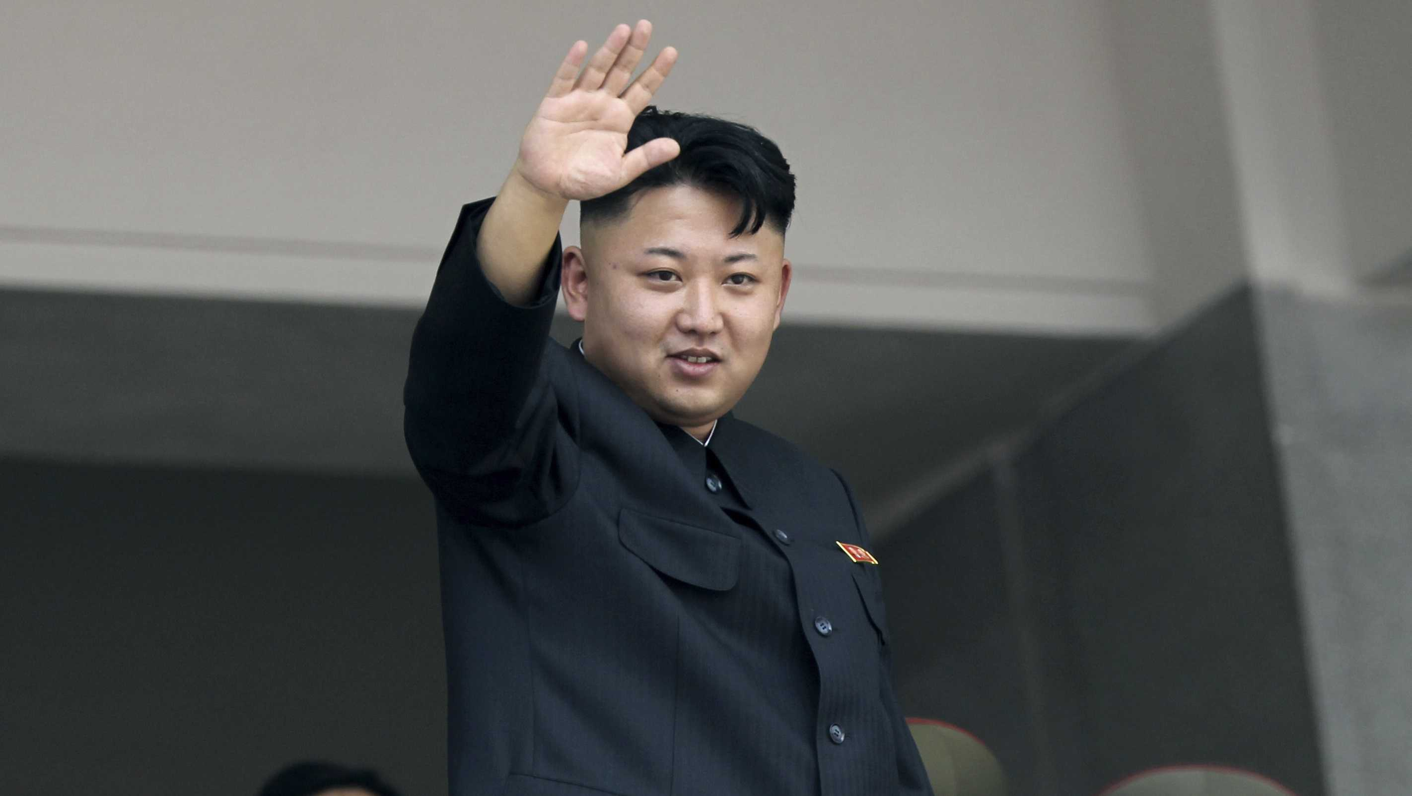 In this July 27, 2013, file photo, North Korea's leader Kim Jong Un waves to spectators and participants during a mass military parade celebrating the 60th anniversary of the Korean War armistice in Pyongyang, North Korea.