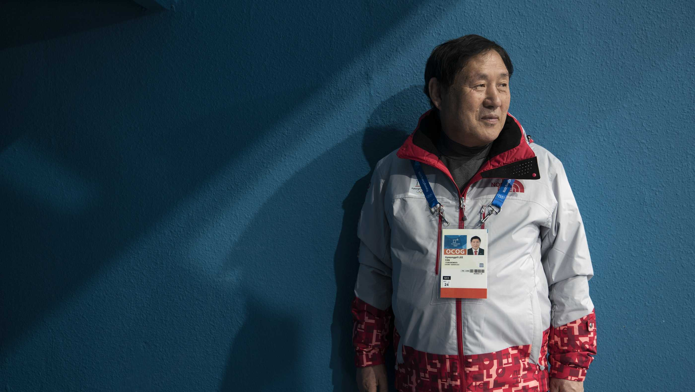Lee Gyeong Pil waits for spectators to arrive at one the entrances of the Gangneung Curling center at the 2018 Winter Olympics in Gangneung, South Korea, Saturday, Feb. 24, 2018. Lee was among five babies born on an American ship that ferried thousands of Korean refugees from North Korea during the Korean War. Nicknamed by U.S. crew as Kimchi 1 through Kimchi 5, they've become a symbol of the South Korea-U.S. military alliance. Lee and Sohn Yang Young were in Gangneung to volunteer for the Olympics as part of their efforts to promote peace and remind younger generations of the lessons they've learned.