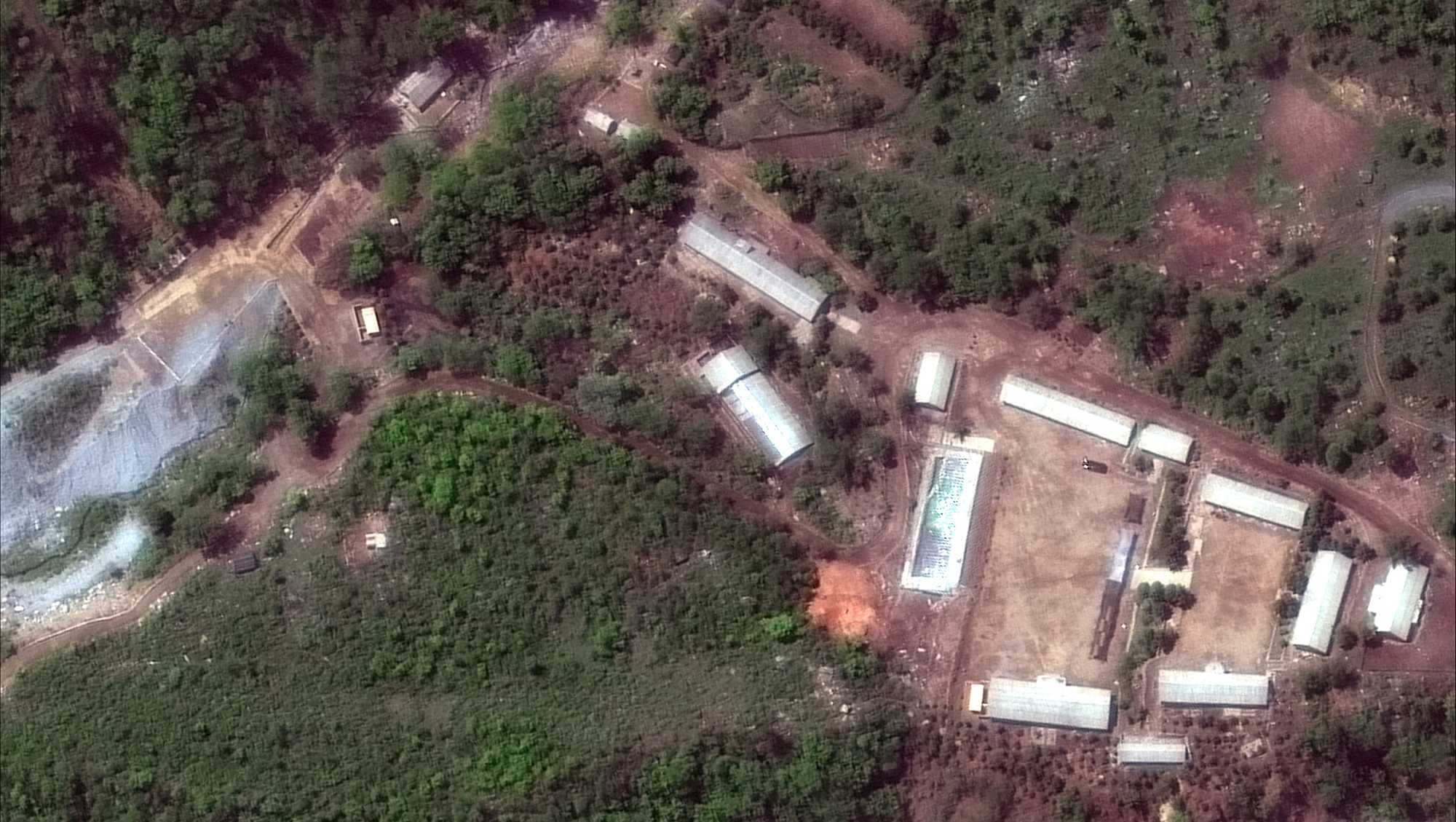 This Wednesday, May 23, 2018 satellite file image provided by DigitalGlobe, shows the Punggye-ri test site in North Korea. North Korea has carried out what it says is the demolition of its nuclear test site in the presence of foreign journalists. The demolition happened Thursday at the site deep in the mountains of the North's sparsely populated northeast. The planned closing was previously announced by leader Kim Jong Un ahead of his planned summit with U.S. President Donald Trump next month.