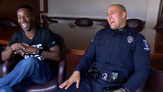 Ken Nwadike Jr. and Officer Chris Frunzi