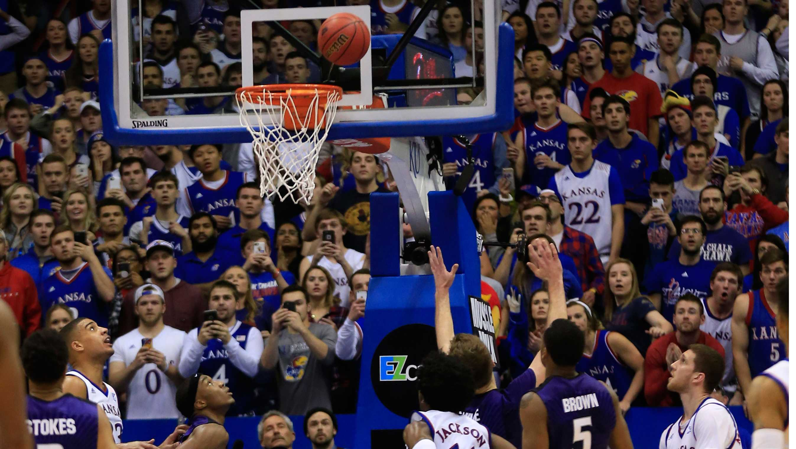 Players watch a last-second basket by Kansas guard Sviatoslav Mykhailiuk, right, during the second half of an NCAA college basketball game against Kansas State in Lawrence, Kan., Tuesday, Jan. 3, 2017. Kansas defeated Kansas State 90-88. (AP Photo/Orlin Wagner)