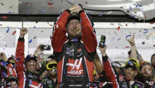 Kurt Busch celebrates in Victory Lane after winning the NASCAR Daytona 500 auto race at Daytona International Speedway in Daytona Beach, Fla., Sunday, Feb. 26, 2017.