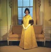 Lady Bird Johnson wearing her inaugural gown in 1965.