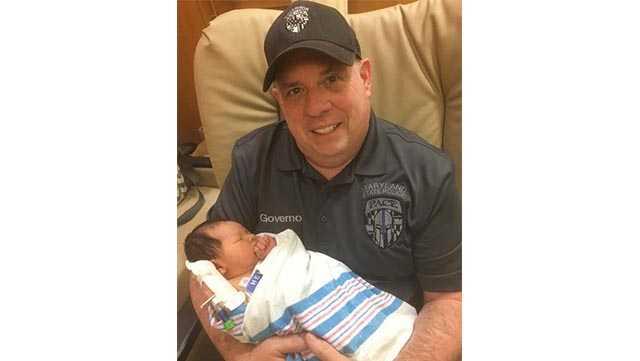 Gov. Larry Hogan holds his newborn grandson, Cam Sterling