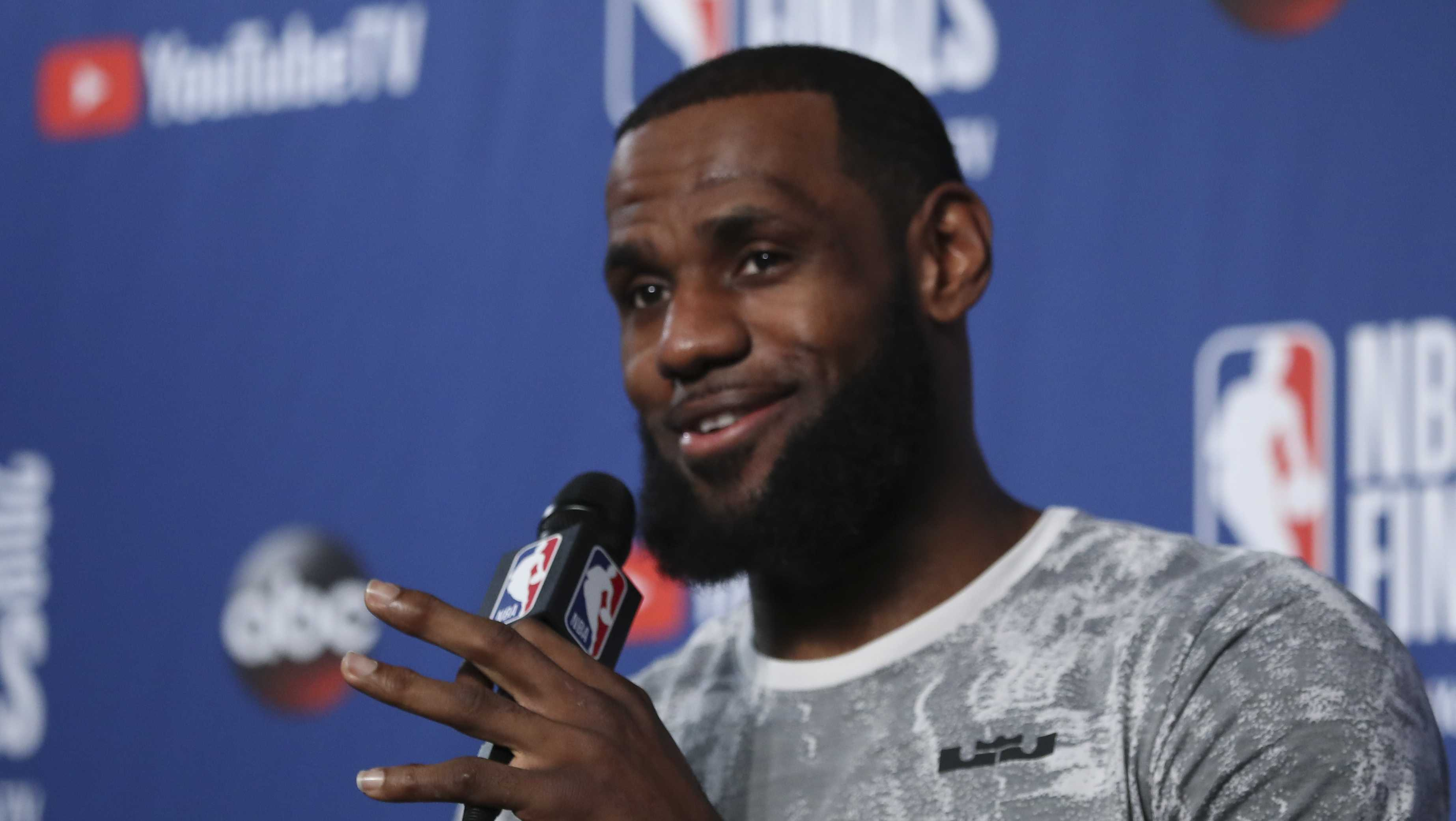 LeBron James takes questions at a press conference during the NBA Finals, Thursday, June 7, 2018, in Cleveland.