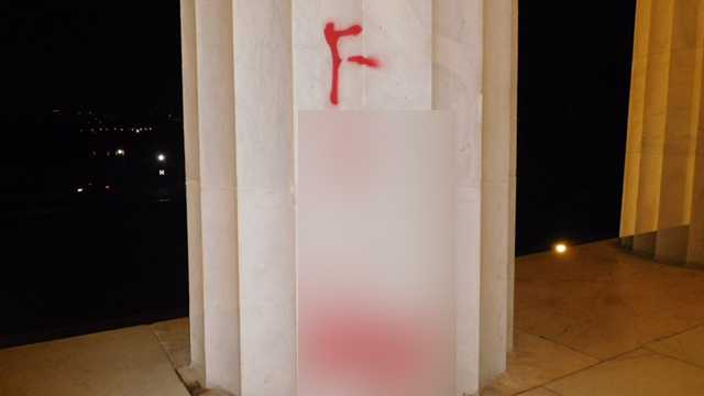 This photo, which has been blurred for graphic content, shows the graffiti left on the Lincoln Memorial early Tuesday, August 15, 2017.