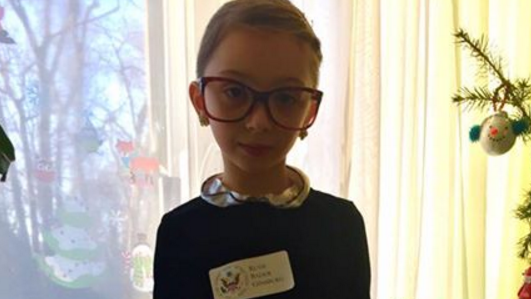 Little girl dressed as Ruth Bader Ginsburg