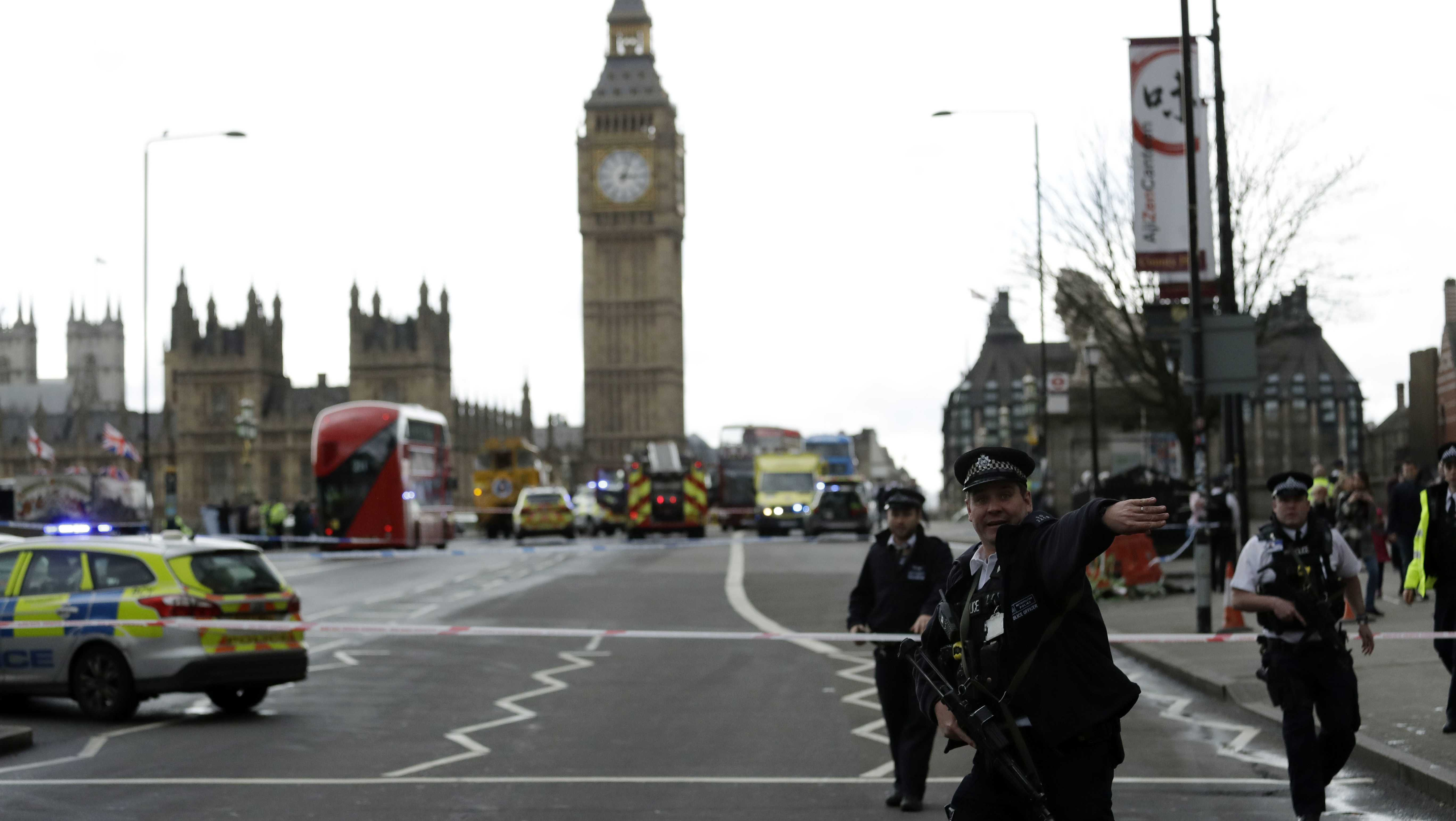 "Police secure the area on the south side of Westminster Bridge close to the Houses of Parliament in London, Wednesday, March 22, 2017. The leader of Britain's House of Commons says a man has been shot by police at Parliament. David Liddington also said there were ""reports of further violent incidents in the vicinity."" London's police said officers had been called to a firearms incident on Westminster Bridge, near the parliament. Britain's MI5 says it is too early to say if the incident is terror-related."